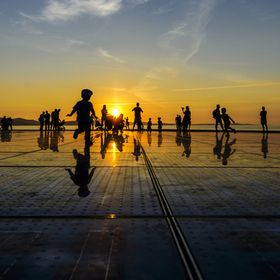 Sunset in Zadar, Croatia by the solar panels and sea organ. Look closely and you will see different ways people go about enjoying the end of the ...
