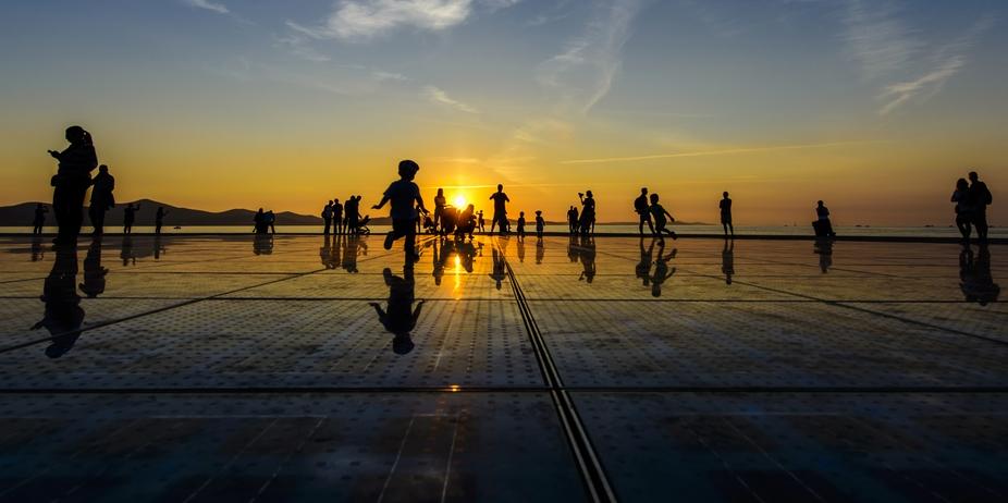 Sunset in Zadar, Croatia by the solar panels and sea organ. Look closely and you will see differe...