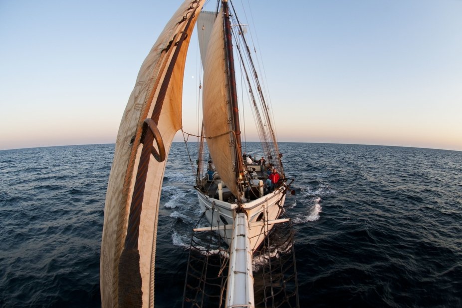 The view at sunset from the tip of the bow sprit on the 125\' schooner Spirit of Massachusetts sai...