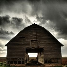 An abandoned barn on a stormy evening.