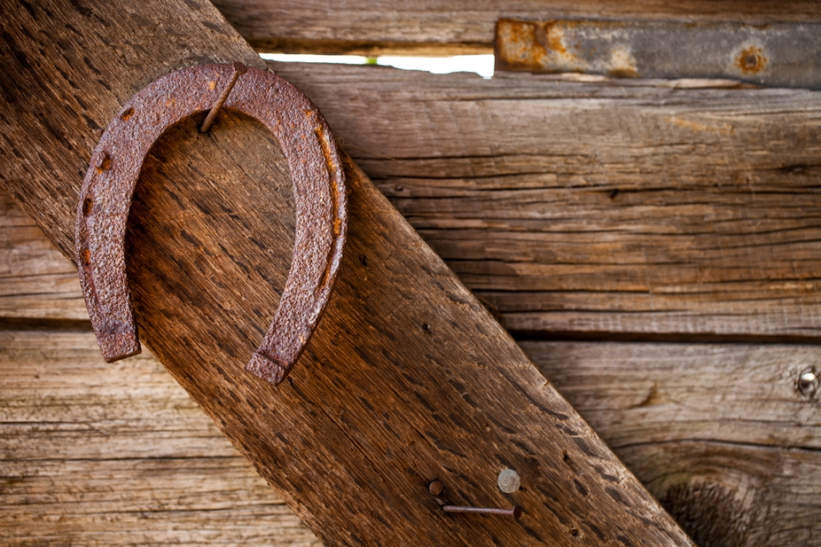 Old times three. Old horseshoe hanging in an old hay barn on an old family farm. These things are...