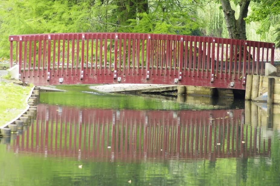 Red bridge.[I took this photo at lake Te ko utu in my home town Cambridge New Zealand.]