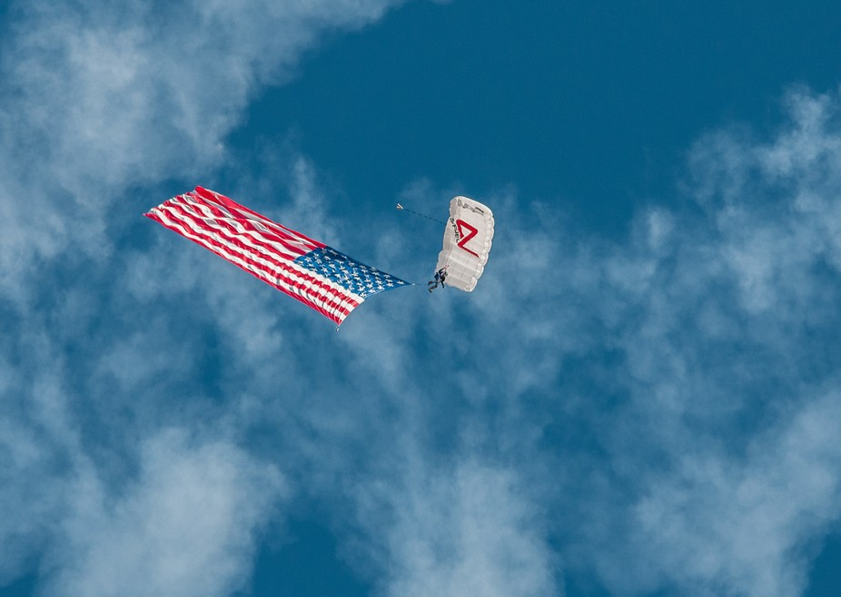 took this shot of a paratrooper and the US Flag at the JBER airshow in Anchorage