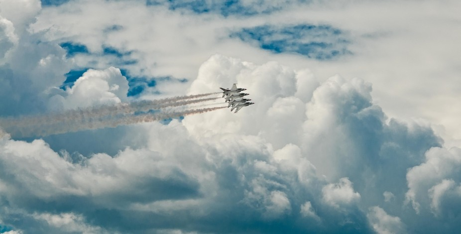 USAF Thunderbirds flying thru the clouds during the JBER airshow