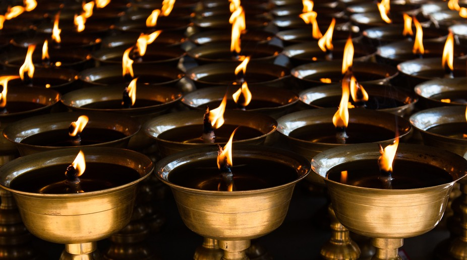 Oil Candles in Leshan, Sichuan, China at a Buddhist temple on Mt. Emei.