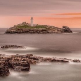 Long exposure,sunset at Godrevy lighthouse in Cornwall UK