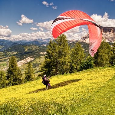 A paraglider finding the breeze above La Villa in the Dolomites...