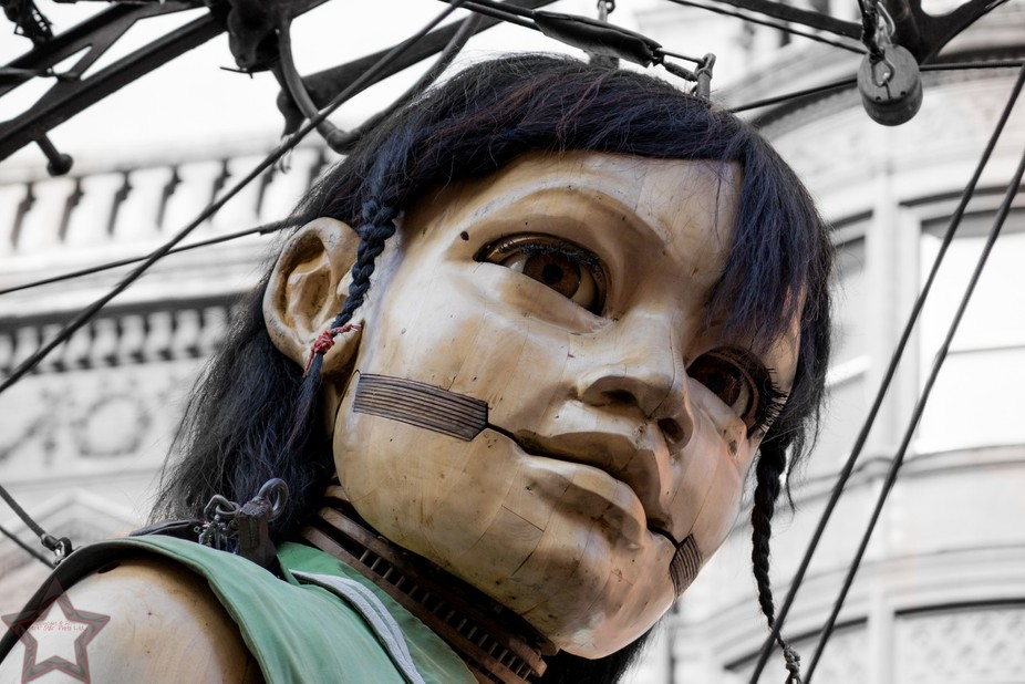 The little girl giant, at the Giant Spectactular production in Liverpool by Royal de Luxe. Photo ...