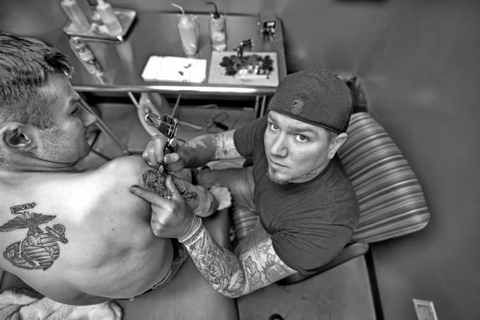 The Tattoo Artist by chrisdemonbreun - Depth In Black And White Photo Contest