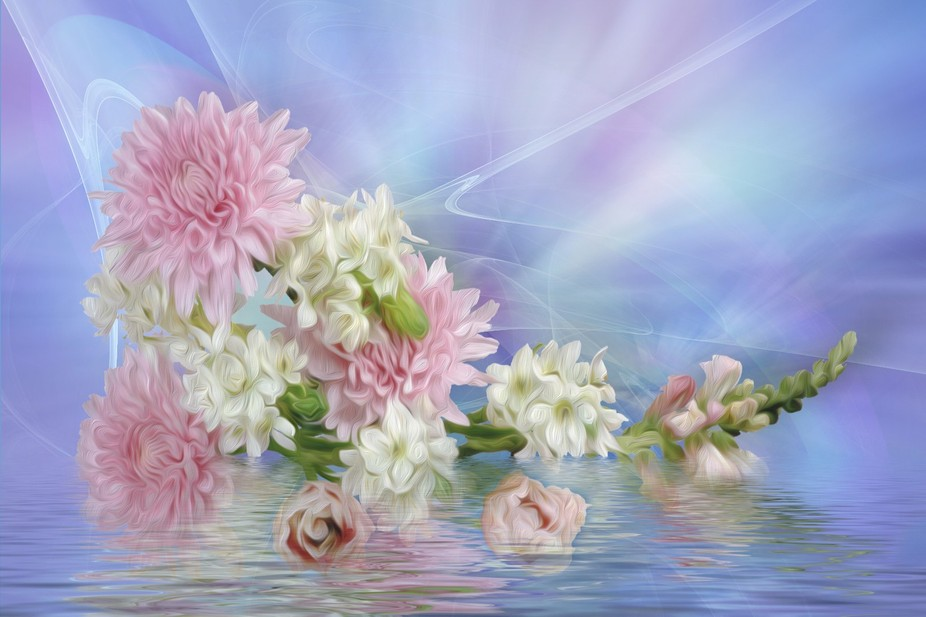 Flowers reflected in water.