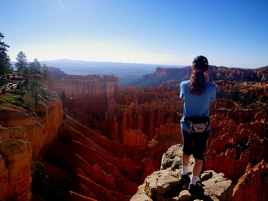 Me standing near the edge of a cliff to take a picture of beautiful Bryce Canyon in Utah!