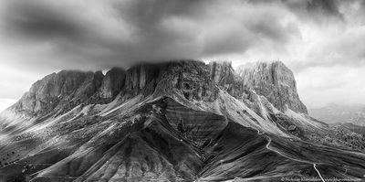 Black ad white panorama of Sassolungo mountain peaks