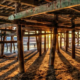 Sunset shadows under the San Clemente pier.