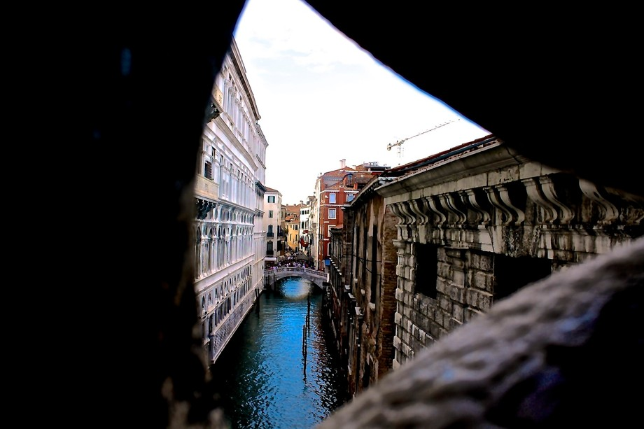 Crossing the bridge of sighs in Venice, Italy