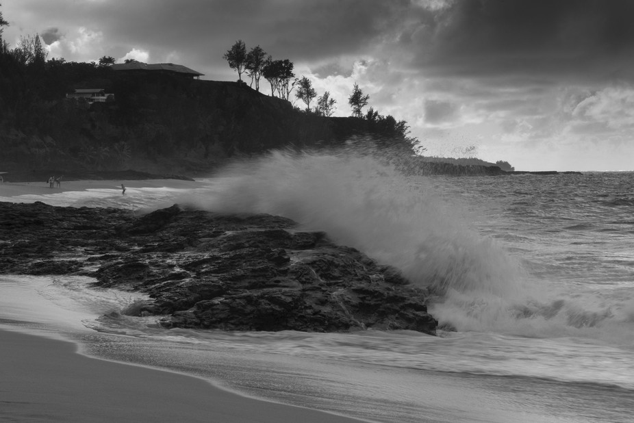 Crashing wave, ominous clouds, evening light and steep cliff create drama at Secret Beach, north ...