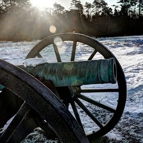 Manassas Battlefield Civil War Cannon in the early morning sunrise on a snowy winter day.