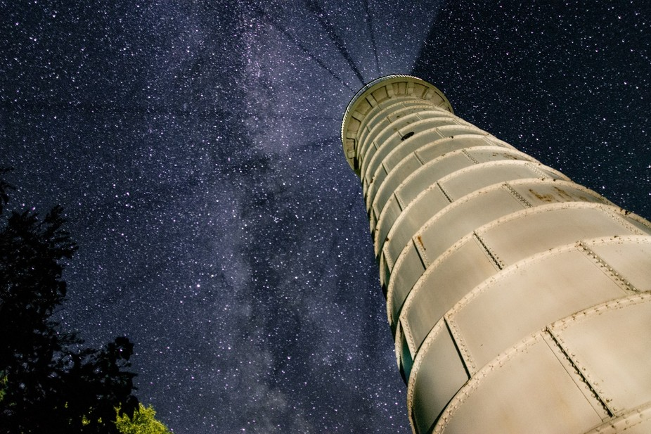 The Cana Island Lighthouse points to the Milky Way while still point it\'s beam out to lake Michig...