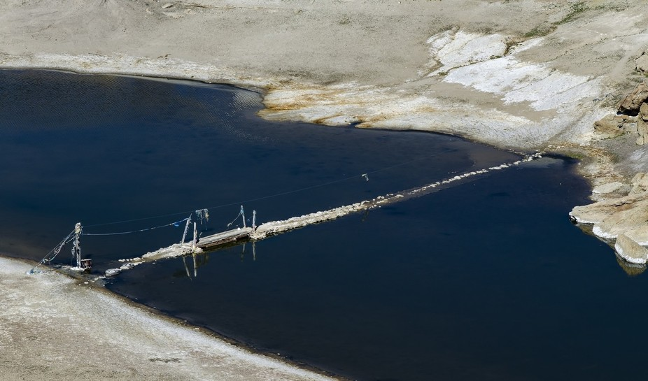This photograph is of a makeshift bridge built by locals near Lake Mansarovar in Tibet (China).