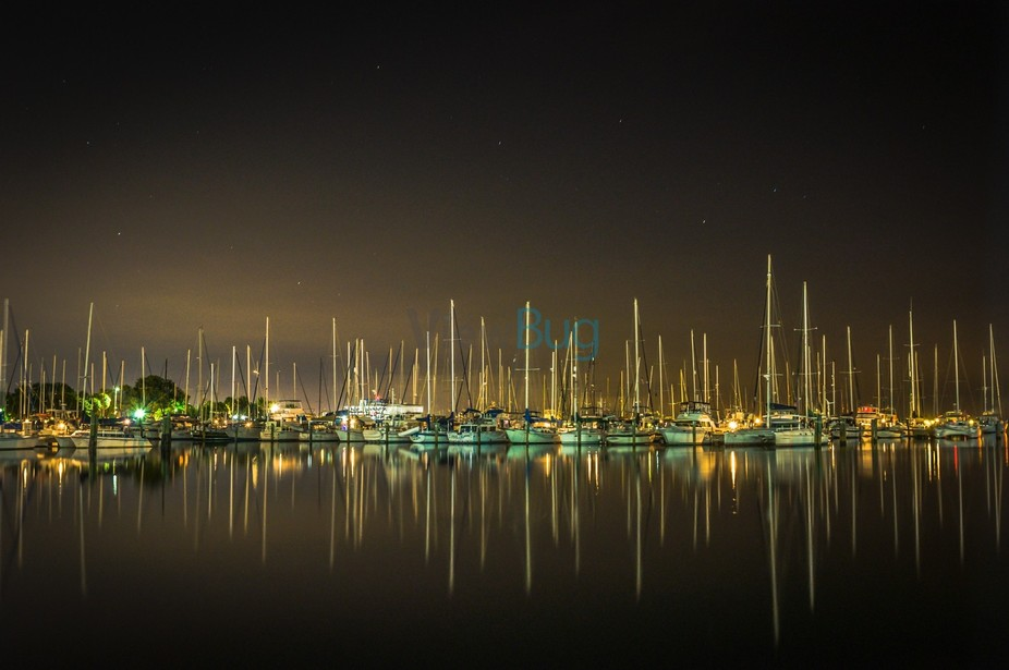 Marina in the South Yacht Basin located in St Petersburg, Florida with sailboats reflecting in th...