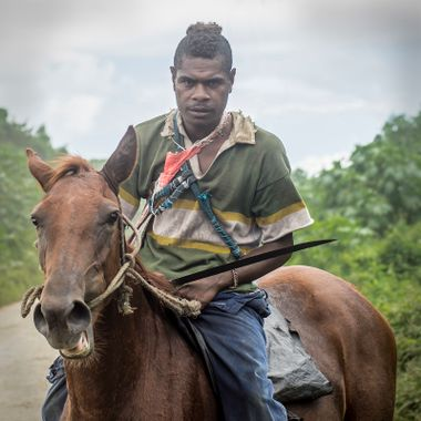 This guy was the local cowboy and butcher on an island in Vanuatu called Tanna. He and his mates were on the way to catch a cow for the markets on the following day. The sword was sharp, the look was mean but he was a really nice guy.