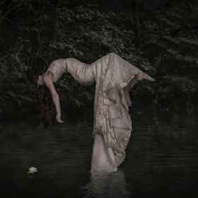 This is a levitation piece. Carlie was balanced on a ladder in the river, after a second exposure without both Carlie or ladder,..hey presto,..la...