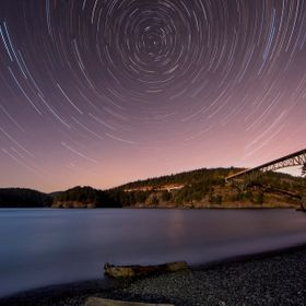 Moon set on Deception Pass in Washington State.