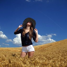 Blue sky and wheat frame a country girl happy to be alive !
