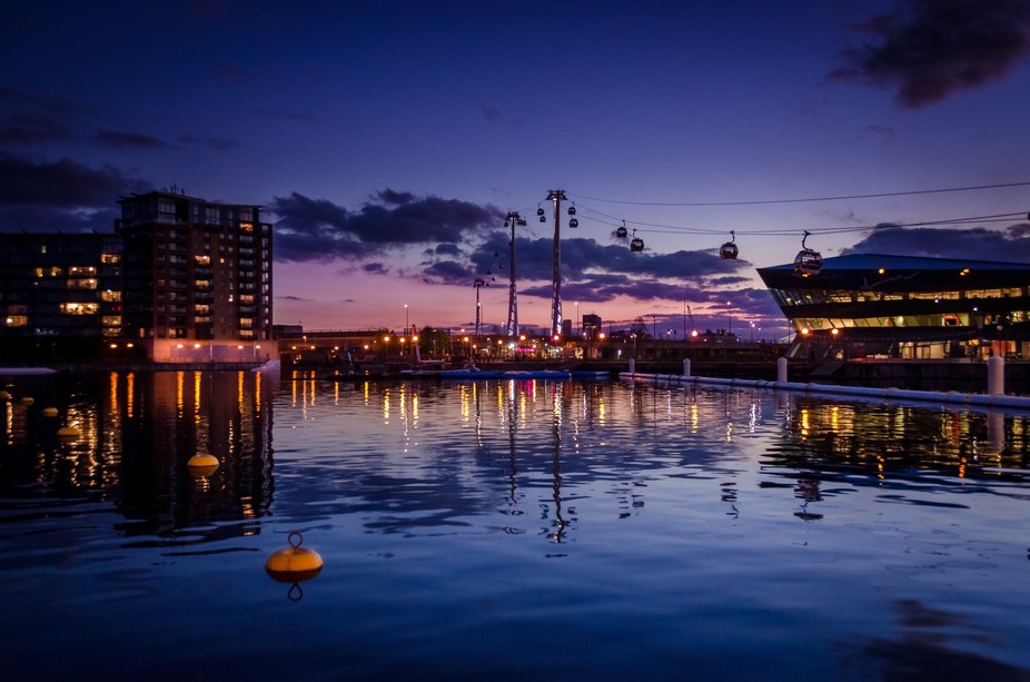 Cable cars in the sunset at Royal Victoria docks, London