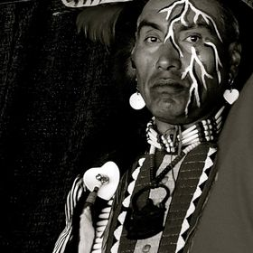 The American Indian man was leaning against a wall at the Pow Wow in Post Falls, Idaho.