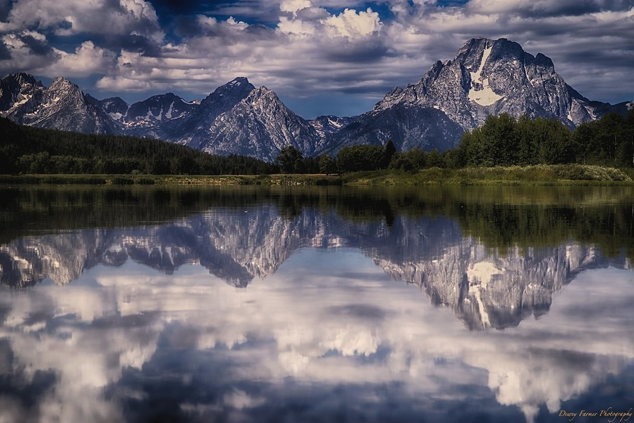 Jackson, Wyoming a bend in the Snake River revealing a mirror finish on the water for a beautiful...