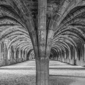 Looking along the laybrothers refectory all the way to the end of the cellarium at Fountains Abbey.