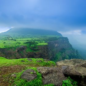 Rain Clouds over Jividhan Fort, Malshej, India. This mountain cliff is breathtaking with a spectacular view of the valley.