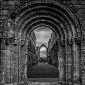 B&W versions of another photo. Looking through the archway down the old nave of Fountains Abbey