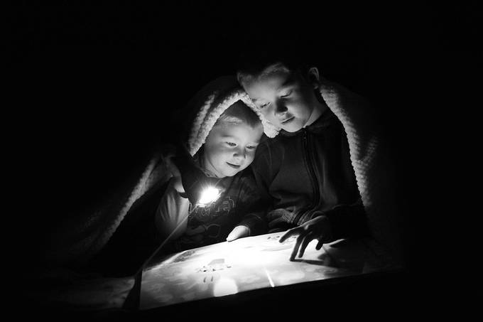 Late night story time by jennparkin - A Black And White World Photo Contest