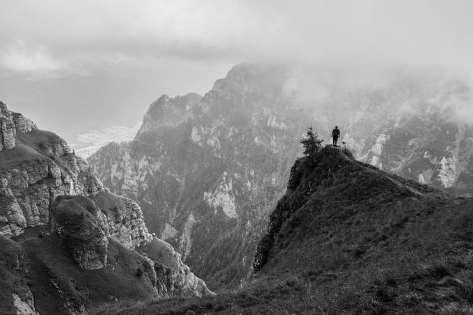 A man and his dog by ajmphoto - Black And White Mountain Peaks Photo Contest