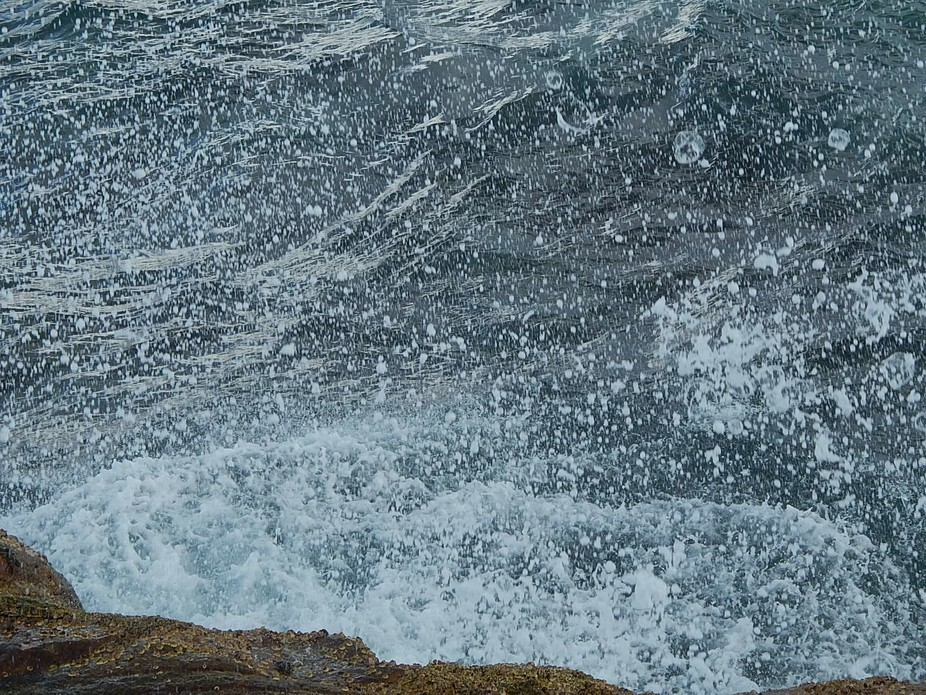I captured the droplets when the water splashed up on the rocks I love this photo