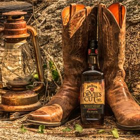 While staying in a log cabin in Idyllwild, California I decided to have some fun with my husband's cowboy boots and a bottle of Jim Beam Whiskey....