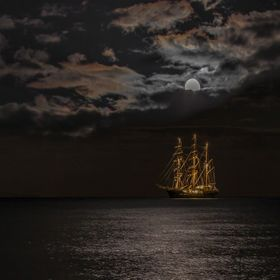 Jubilee Sailing Trust tall ship swings on its anchor in Swanage Bay, two days after a 'supermoon'.