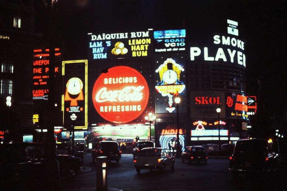 This is a night shot of Piccadilly Circus at night in London, England in June, 1966. *  Camera us...