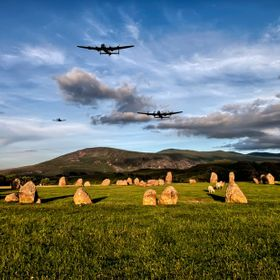 Composite image showing Two Lancaster Bomber with their fighter escort flying over the Stone Circle at Castlerigg, just outside Keswick in the La...