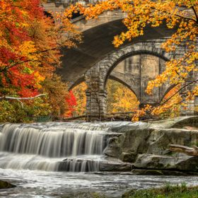 Berea Falls Ohio during peak fall colors. This cascading waterfall looks it's best with peak autumn colors in the trees.