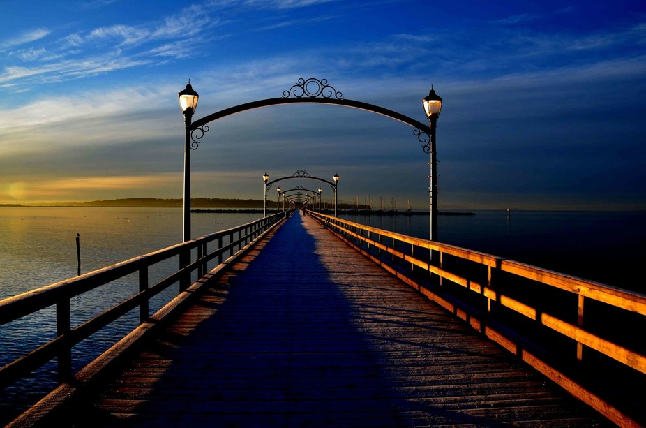 Sun coming up on a January morning at the White Rock Pier in British Columba Canada.