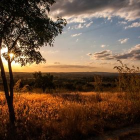 The sun sets over the foothills of the Copper Belt in Zambia, Africa.