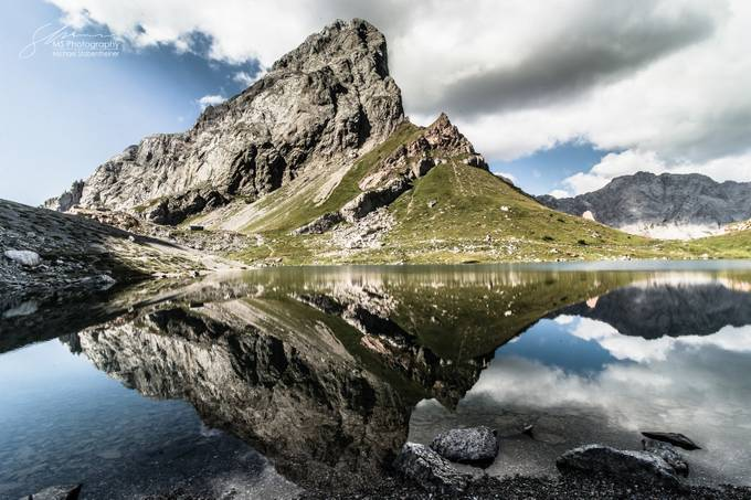 Mountain reflection by michaelstabentheiner - Large Photo Contest