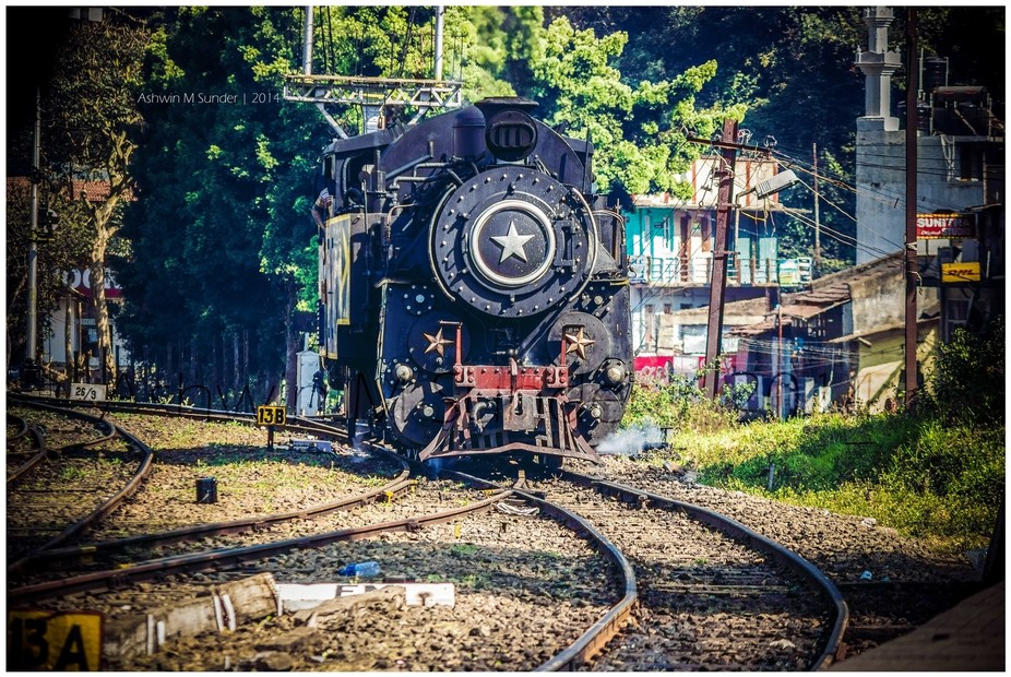 The Niligiri Express arriving at the station for its spectacular journey to Ooty through the Nilg...