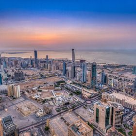 An aerial view of Kuwait bustling skyline in Sharq. The tallest building in this picture is United Towers (KIPCO Building) standing at 240m with ...
