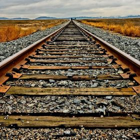 The railroad tracks carry huge freight trains that cross Idaho.