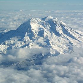 I took this shot of Mt Rainer while flying from Oregon into Washington.  It was as beautiful when I saw it poking up through the clouds, as it is...