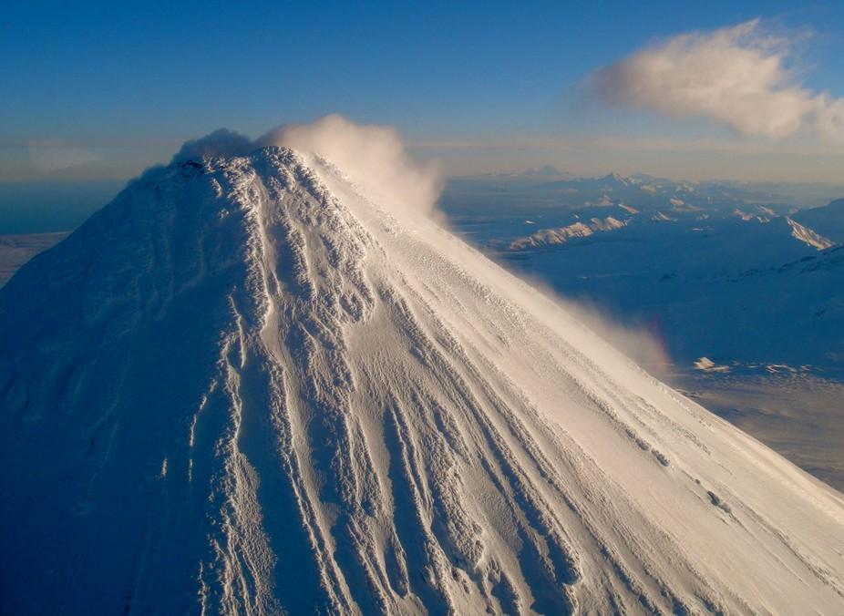Shishaldin Volcano on the Aleutian Chain vents on a winter morning.