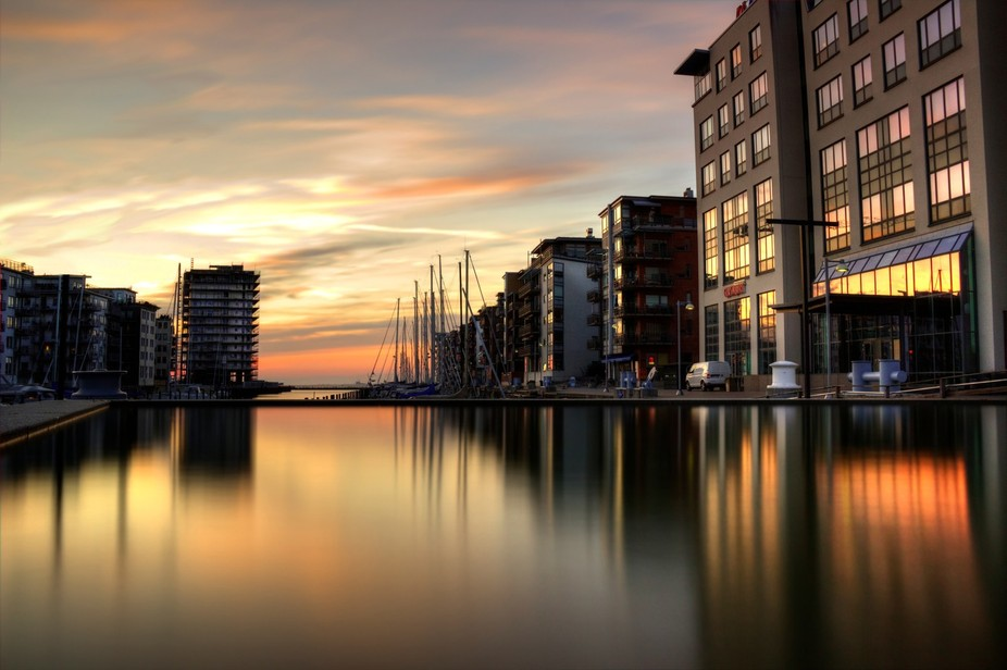 A city district of Malmö that is situated close to the sea. The buildings are reflected in the w...